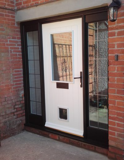 white timber front door with cat flap