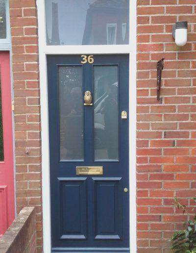 blue number 36 timber front door