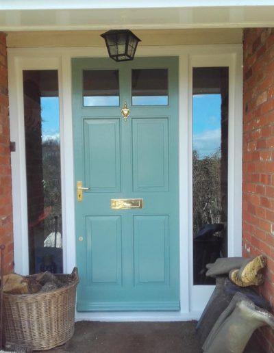 teal timber front door