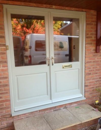 white timber pairs front door