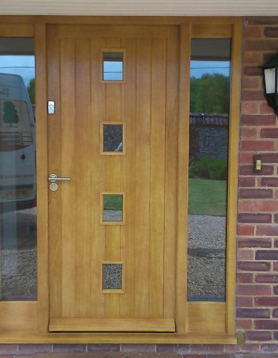 modern yellow timber front door with windows