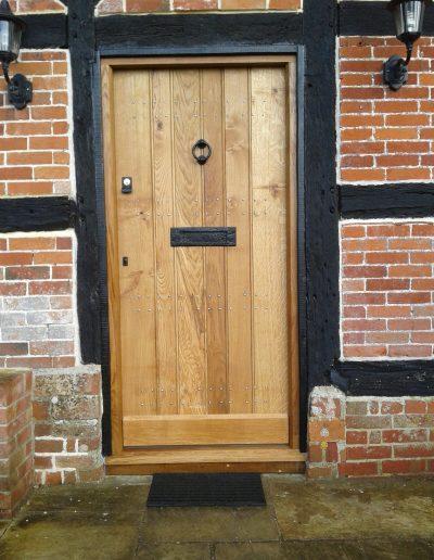 beautiful studded timber door with knocker