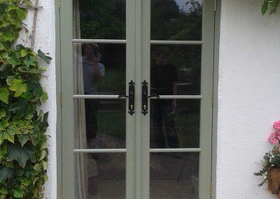 green paired doors