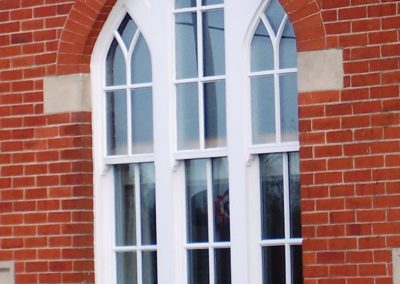 timber arched sash window