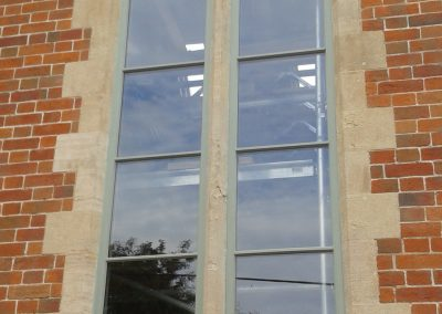 timber curved windows with stone mullion