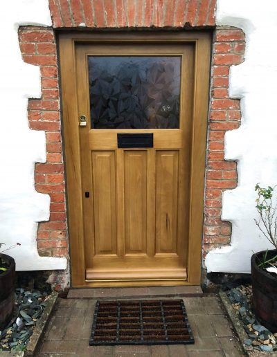 stained timber front door