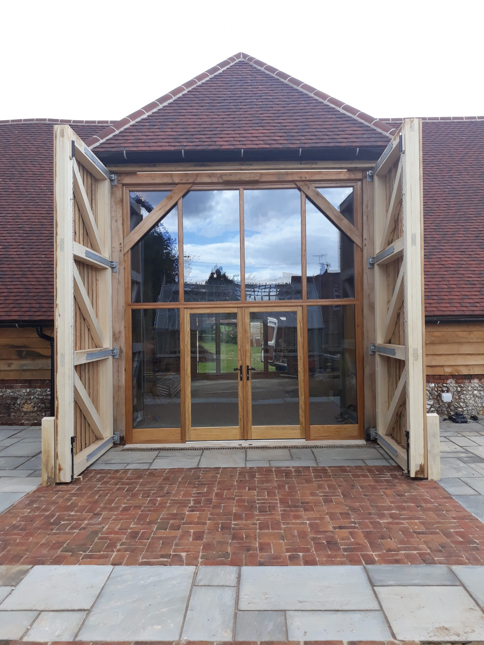 Timber barn doors with glazed screen