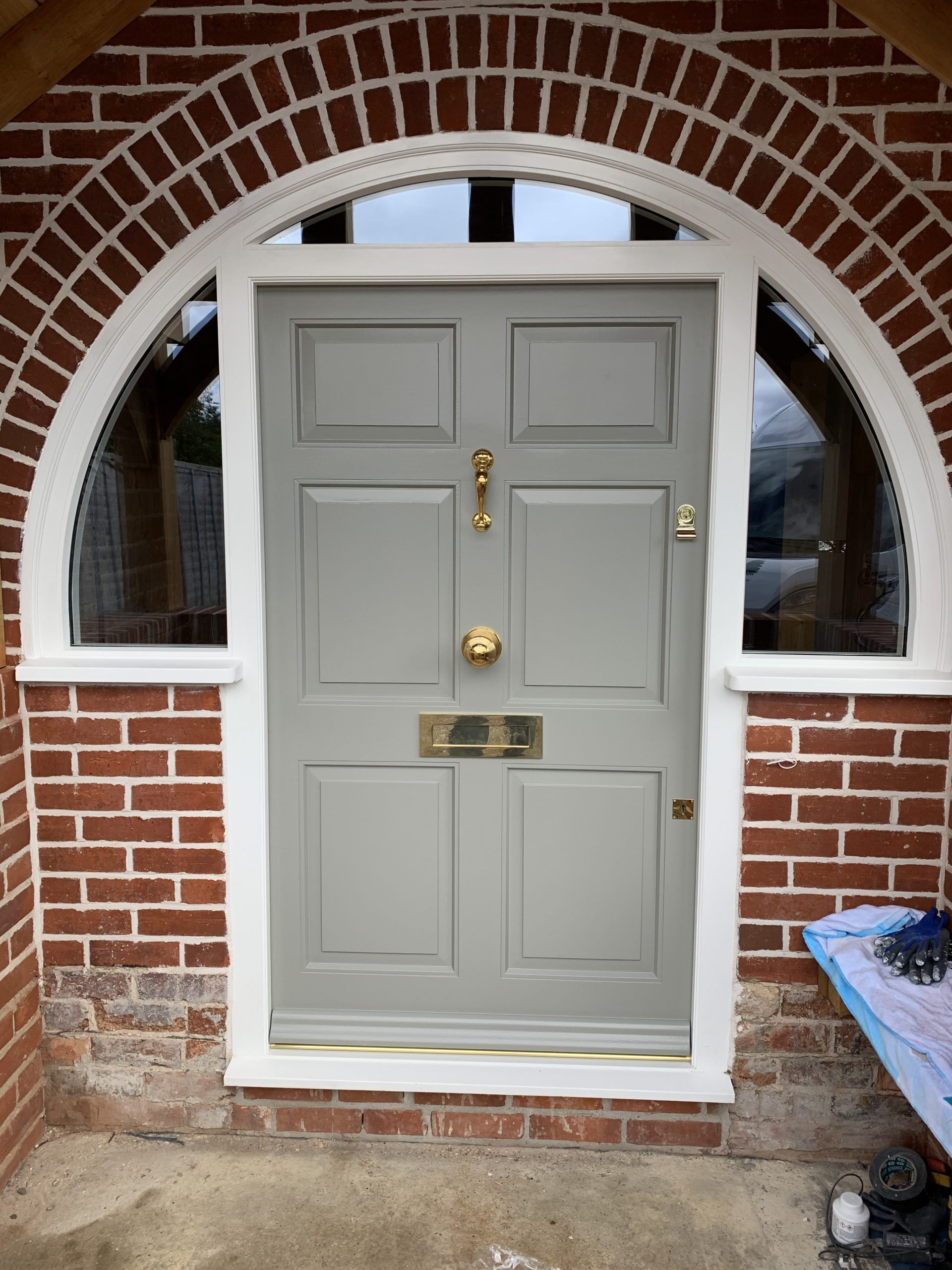 Front door with curved frame