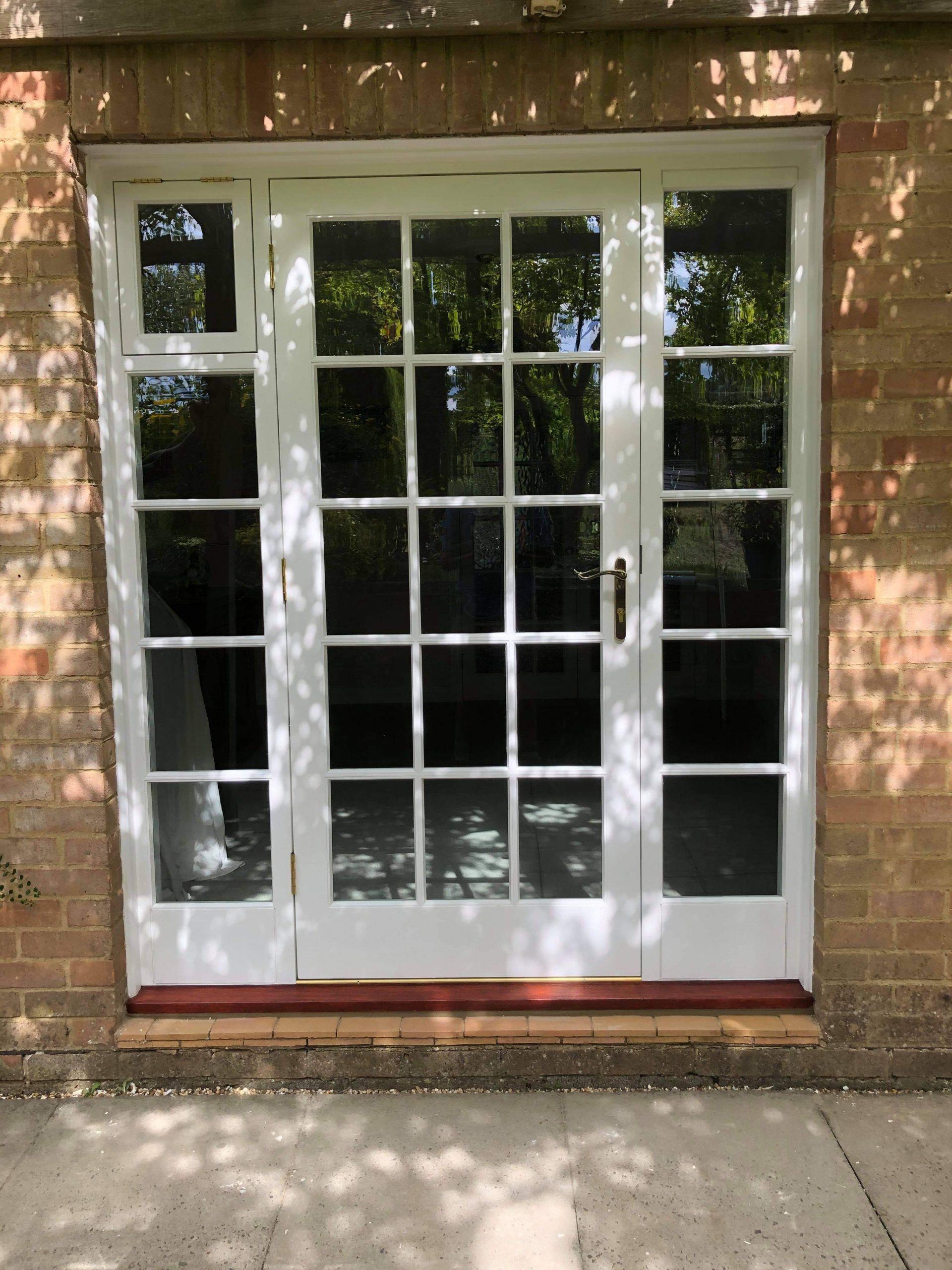 Glazed door with sidelights